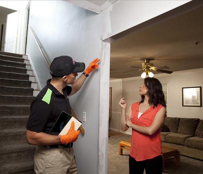 SERVPRO employee talking to a customer